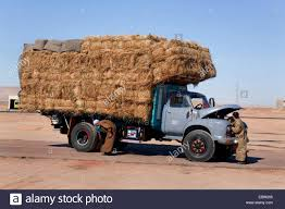 Truck With Hay Bales And A Motor Mechanic In Front Of The Engine ... Truck Carrying Hay Rolls In Davidsons Lane Moore Creek Near Hay Ggcadc Flickr Bale Bed For Sale Sz Gooseneck Cm Beds Parked Loaded With Neatly Stacked Bales Near Cuyama My Truck And The 8 Rx8clubcom On A Country Highway Stock Photo Image Of Horse Ranch Filescott Armas Truckjpg Wikimedia Commons Hits Swan Street Richmond Rail Bridge Long Delays Early Morning Fire Closes 17 Myalgomaca Oversized Load On Chevy Youtube Btriple Trucks Allowed Oxley To Ferry Relief The Land A 89178084 Alamy