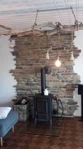 landhaus steinwand wohnzimmer gemütlich steinwand