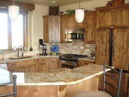 Marvelous Pine Kitchen Cabinets With Cool Juicer And Electric Stoves Also Cute White Chandelier Wonderful