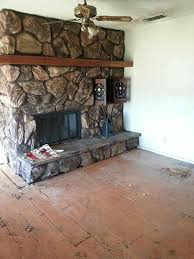 Painting huge rock fireplace