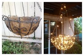 DIY Outdoor Chandelier Made From A Hanging Planter Fishing Line And Christmas Lights