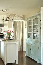 Small Interior Kitchen Room With Cream Wall And White Island Plus Rustic Blue Storage Cutlery Sets