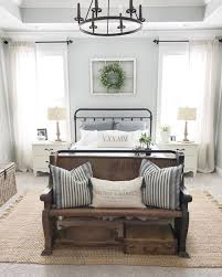 i adore this farmhouse style bedroom with the antique wood bench