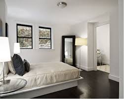 Contemporary Dark Wood Floor And Brown Bedroom Idea In New York With White Walls
