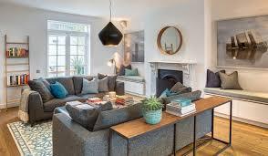 salon canapé gris decoration table console bois massif acier noir salon blanc