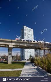 100 Holland Park Apartments Skytrain Passes In Front Of Modern Apartment Building