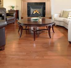 Hardwood Floor Vs Laminate In Living Room Area Decorated With Round Wooden Table And Brown Leather