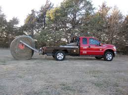 patented parallel squeeze bale pikup technology by deweze