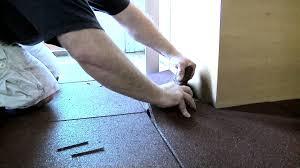 installing rubber flooring tiles