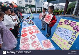 Children Introduce Paper Cuttings In A Charity Bazaar During Campus Cutting Festival At Kindergarten Changxing County East Chinas Zhejiang