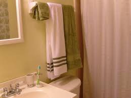 Bathroom How To Fold Towels Keep Them Hanging Straight In Your