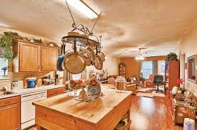 hanging pot rack wood island kitchen ideas for