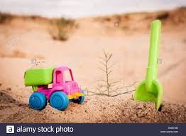 Toy Dump-truck In The Sands With Big Spade Stock Photo: 84516141 - Alamy