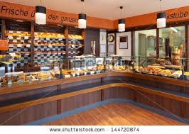 Modern Bakery Interior With Glass Display Counters Full Of Scrumptious Bread And Pastries