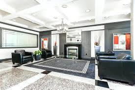 Contemporary Living Room Designs Design With Black Leather Armchairs Modern Fireplace And Polished