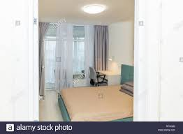 Hotel Bed And Office Table Desk Chair With Lamp In Bedroom ... Desk Chair And Single Bed With Blue Bedding In Cozy Bedroom Lngfjll Office Gunnared Beige Black Bedroom Hot Item Ergonomic Home Fniture Comfotable Chairs Wheels Basketball Hoop Chair Bedside Tables Rooms White Bedrooms And Small Hotel Office Table Desk Lamp Wooden Work In Stool Space Image Makeup Folding Table Marvellous Computer Set 112 Dollhouse Miniature 6pcs Wood Eu Student Main Sowing Backrest Solo Stores Seating Reading 40 Luxury Modern Adjustable Height
