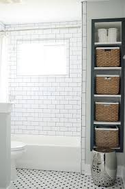 recessed vertical bathroom shelves with seagrass bins