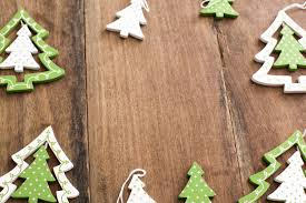 Festive Frame Of Wooden Green Christmas Tree Ornaments In The Shape Traditional Xmas Trees On