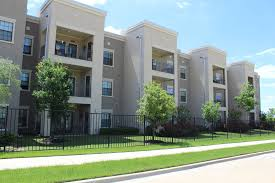 Exterior Apartment Building at Oxford at Crossroads Centre Apartments in Waxahachie TX