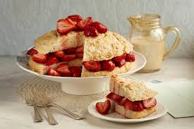 Strawberry shortcake with a slice cut out on a separate plate