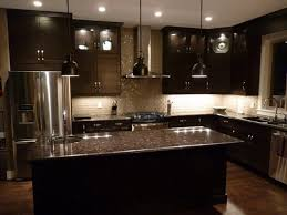 dark kitchen cabinets with light floors white gloss island with
