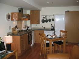 ApartmentMinimalist Studio Apartment Furniture With Corner Wooden Kitchen Cabinet And Simple Dining Area Choosing