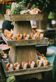 A Cajun Themed Menu Featuring Tiered Stand Lined With Glasses Of Seafood Salad Topped