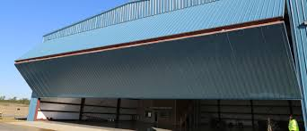 Aircraft Hangar Doors | Home Interior Furniture Hangar Homes Are Unique They Combine An Airport With A Bman Livework Airplane James Mcgarry Archinect The Top Modern Designs In Aviation Hangars Themocracy Aircraft Home With Sliding Door Doors Interior Fniture Stunning Floor Plan Ideas Flooring Area Rugs Best Pictures Design R M Steel And Photos Decorating Midwest Texas Mannahattaus Wood Plans Latest 2017