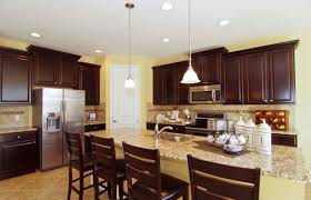 stunning kitchen cabinets with light granite countertops and
