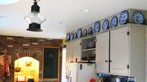 how to decorate above kitchen cabinets ideas for decorating over