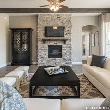This Living Room Features A Gorgeous Stone Fireplace Beam