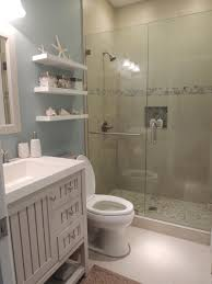 Guest Bathroom Decorating Ideas Pinterest by Beach Theme Bathroom Stone Shower Floating Shelves Shell Decor