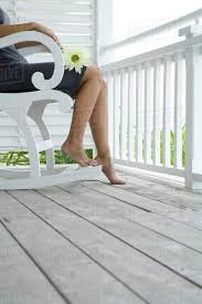 Woman Sitting In Rocking Chair On Porch, Holding Flower On D1144_4_980 Rocking Chair For Nturing And The Nursery Gary Weeks Coral Coast Norwood Inoutdoor Horizontal Slat Back Product Review Video Fort Lauderdale Airport Has Rocking Chairs To Sit Watch Young Man Sitting On Chair Using Laptop Stock Photo Tips Choosing A Glider Or Lumat Bago Chairs With Inlay Antesala Round Elderly In By Window Reading D2400_140 Art 115 Journals Sad Senior Woman Glasses Vintage Childs Sugar Barrel Album Imgur Gaia Serena Oat Amazoncom Stool Comfortable Cushion