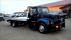 International 4700 With Chevron Rollback Tow Truck For Sale - YouTube