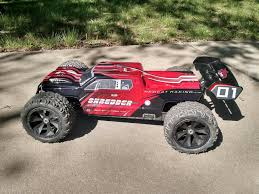 Shredder 1/6 Scale 4WD Brushless Electric Monster Truck – Amazing RC ... Traxxas Xmaxx 16 Rtr Electric Monster Truck Wvxl8s Tsm Red Bigfoot 124 Rc 24ghz Dominator Shredder Scale 4wd Brushless Amazing Hsp 94186 Pro 116 Power Off Road 110 Car Lipo Battery Wltoys A979 24g 118 For High Speed Mtruck 70kmh Car Kits Electric Monster Trucks Remote Control Redcat Trmt10e S Racing Landslide Xte 18 W Dual 4000 Earthquake 8e Reely Core Brushed Xs Model Car Truck