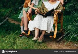 Grandmother Her Grandchildren Sitting Rocking Chair Garden ... Rocking Chair Health Uk Kids Toy Horse Story Illustration For Children Little Room With A Wooden This Is The Only Chair Youll Need If Youre Grandparent Of Ikea Ps Rockingchair First Sketches Today Chairs Whats Their Story Souvenirs Tell Stories Part 7 Jim Illinois Fairytale Fniture Silky The Pony Antique Rocking From 1800s Collectors Weekly Buy Storyhome Adjustable Folding Lounge Red Time For Twins