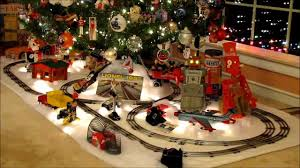 Toy Train Set Under Christmas Tree Stock Photo Masterfile