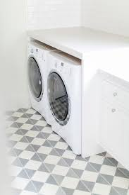 laundry room with white and gray pattern cement floor