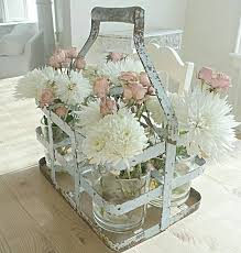 Old Milk Jug Carrier Using To Hold Mason Jars With Flowers For Table Decor Farmhouse Kitchen