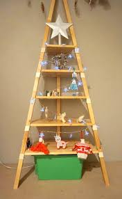 3 Hang Decorations Off The String Of Lights 4 Place A Large Star Or Angel On Top Shelf 5 Turn An Enjoy Christmas