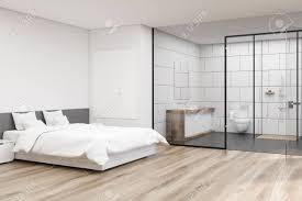 ecke eines schlafzimmerinnenraums mit einem großen doppelbett und einem badezimmer mit glas und weißer wand 3d rendering mock up
