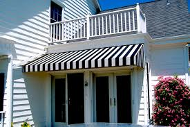 Black and Silver Striped Awning over Patio Doors at Private Residence