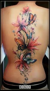Lily Flower And Butterfly Back Tattoo Design