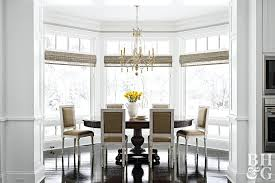 Dining Room With Woven Shades On Bay Windows Window Treatment Ideas And Bow Living