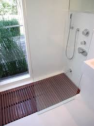 that looks like an in ground bathtub with a wooden mat