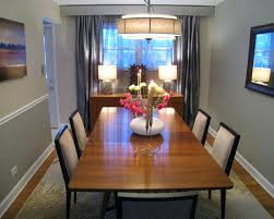 Under Window Table Using A Variety Of Buffet Modern Chairs With Wood And Candle