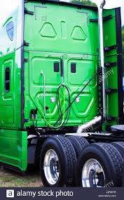 A Big Green Modern Rig Semi Truck With A High Cabin With Flat Rear ...