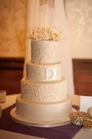 Elegant White Icing Wedding Cake Decorations Sweet Purple Napkins Matched With Beautiful White Wedding Cake Decoration Flowers