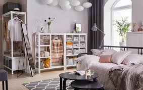 White And Pink Open Plan Living Room With Storage Across The Back Wall