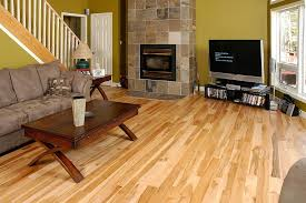 Natural Maple Wood Flooring With A Custom Fireplace